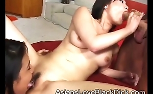 2 Simmering Chinese babe team up to blow huge foreign cock