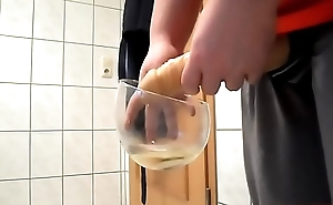 Slave with fake cock pissing