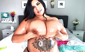 Hot BBW oils her effectively boobs and plays in them